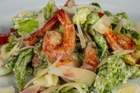 Photo for Tasty caesar salad with shrimps - Royalty Free Image