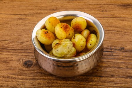 Photo for Roasted young baby potato in the bowl - Royalty Free Image