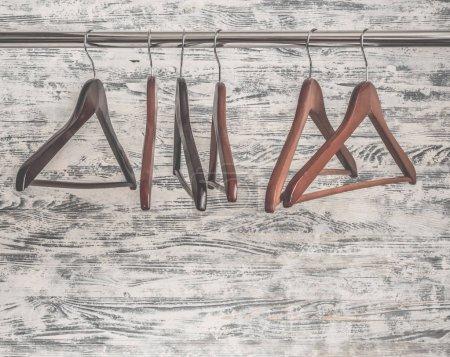 Brown wooden hangers on the rack