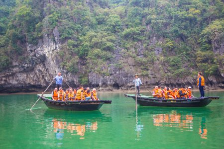 HALONG, VIETNAM - JUNE 17, 2018: Tourists in boats in Halon bay, Vietnam in a summer day