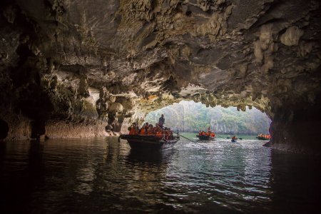 HALONG, VIETNAM - JUNE 17, 2018: Tourists exploring cave in Halon bay, Vietnam in a summer day