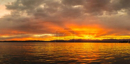 Photo for Panorama of Sunset on Garda lake in Italy in a beautiful summer evening - Royalty Free Image