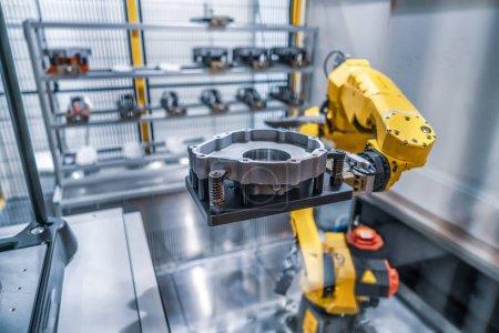 Photo pour Robotic Arm lignes de production moderne technologie industrielle. Cellule de production automatisée. - image libre de droit