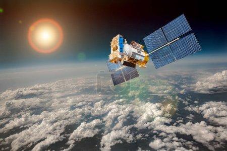 Photo pour Satellite spatial en orbite autour de la Terre. Éléments de cette image fournis par la NASA. - image libre de droit