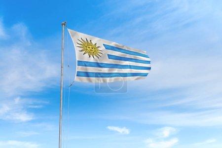 Photo pour Drapeau de l'Uruguay soufflant dans le vent sur un beau fond bleu ciel - image libre de droit