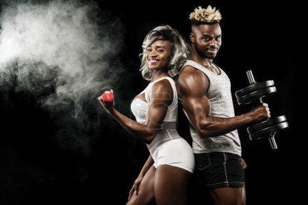 Photo for Young attractive couple practicing workout, healthy lifestyle body care - Royalty Free Image