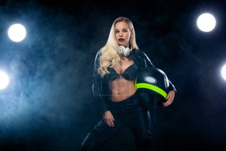 Photo for Fashion model in sunglasses, black leather jacket, leather pants. stylish pretty blonde woman in night spring casual outfit,Wearing dark blouse, black biker jacket, Long wavy hairstyle. - Royalty Free Image