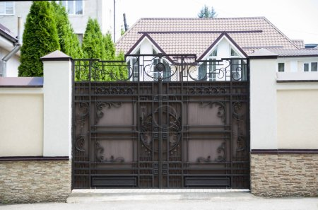 Photo for Beautiful, original gate with forging elements - Royalty Free Image