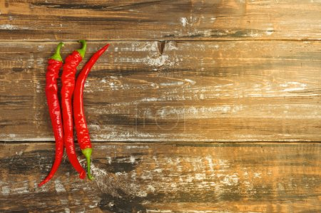 Photo for The composition of chili red hot peppers on wooden table. Top view flat lay group objects - Royalty Free Image