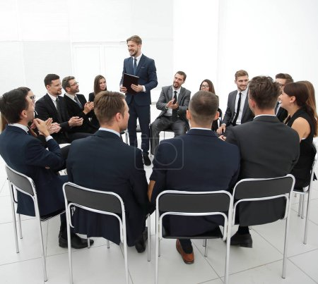 Photo for Business people applauding the coach after the lecture . business concept - Royalty Free Image