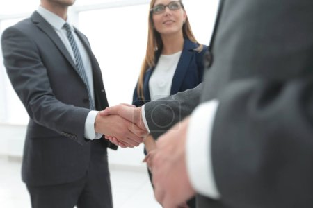 Business shaking hands in the office