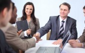 handshake business partners at a business meeting