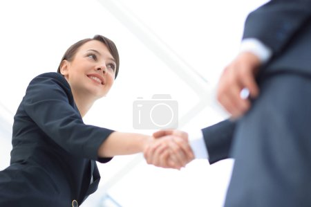 Photo for Background image of business partners handshaking.close-up.the business concept. - Royalty Free Image