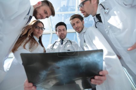 doctors colleagues look at the x-ray of the patient