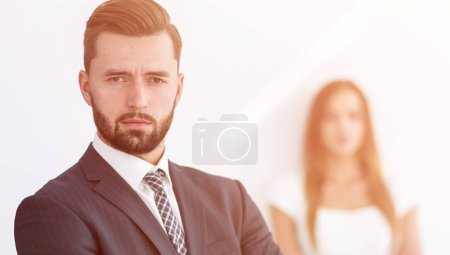 Portrait of a businessman with a woman in the background