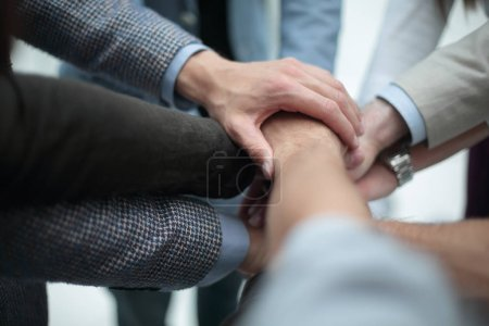 Photo for Close up.business team putting their hands together. the concept of unity - Royalty Free Image