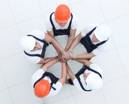 Photo for Group of workers standing in circle top view - Royalty Free Image