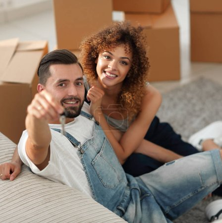 young couple holding the key to a new apartment