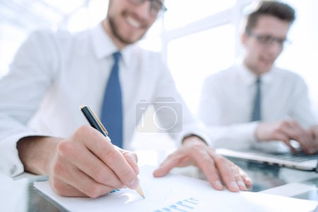 Photo for Businessman check about cost and doing finance graph report at office.business concept - Royalty Free Image