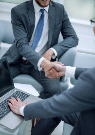 close up. businessman shaking hands with business partner