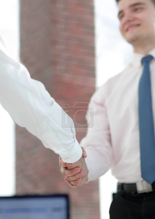 closeup. business handshake.business background.