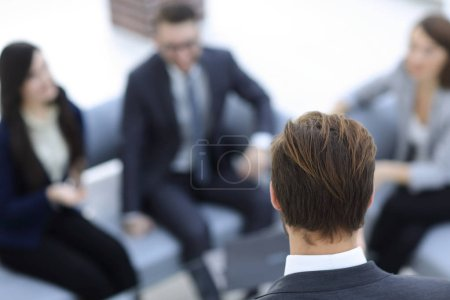 Business and office concept - business team having meeting in of