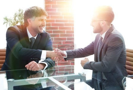 Photo for Business partners shake hands after discussing the contract. The concept of partnership - Royalty Free Image
