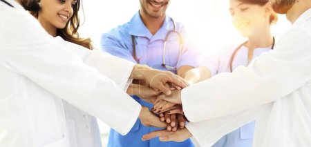 Photo for Doctors and nurses stacking hands.concept of mutual aid. - Royalty Free Image
