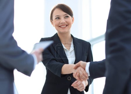 Photo for Businesswoman shaking hands with a businssman during a meeting.concept of partnership - Royalty Free Image