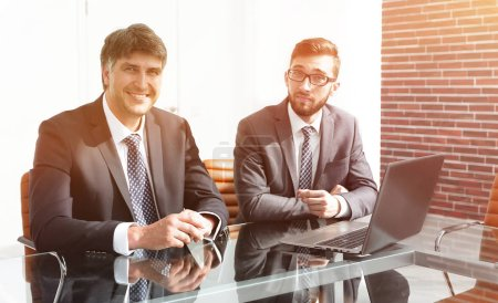 Photo for Two successful employees sitting at the desk. Photo with copy space - Royalty Free Image