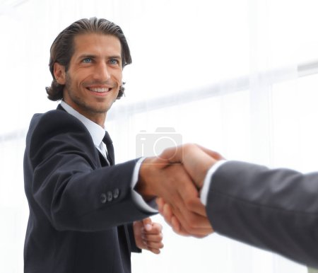 Photo for Closeup.business group welcomes partner with a handshake - Royalty Free Image