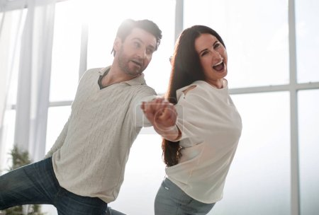 loving couple hugging each other in new apartment