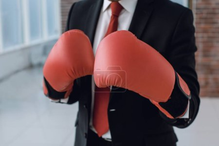 close up.businessman in Boxing gloves