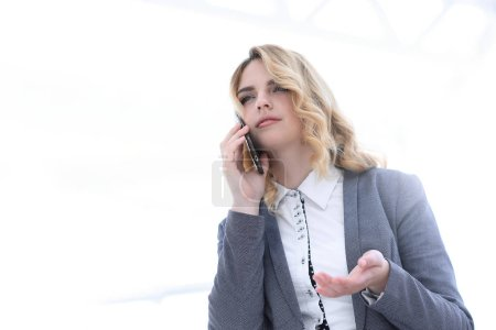Successful business woman, discussing the smartpho...