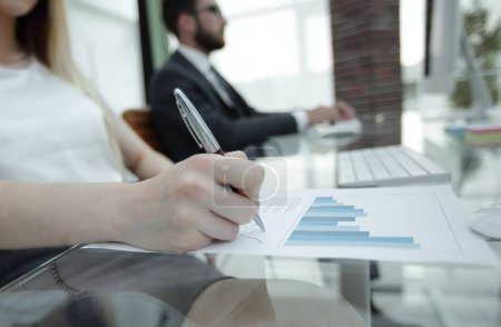 business woman working with financial documents.
