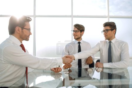 handshakes of business people in a modern office