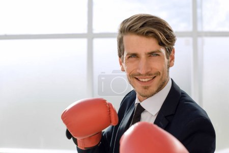 Businessman standing posture with boxing gloves