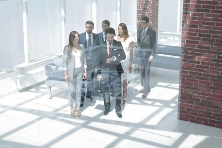 Photo for Behind the glass.business team, businesspeople group walking at modern bright office interior - Royalty Free Image