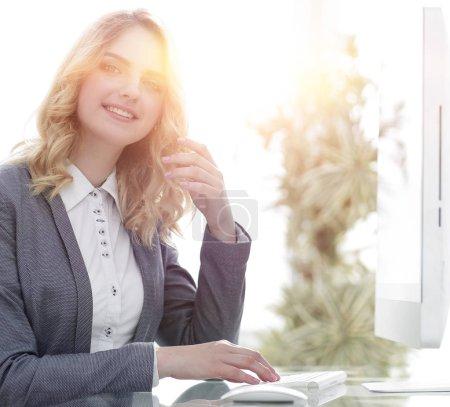 modern business woman sitting at a Desk.
