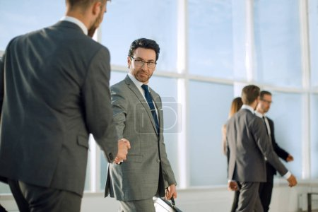 Photo for Business partners shake their hands in modern open space office - Royalty Free Image