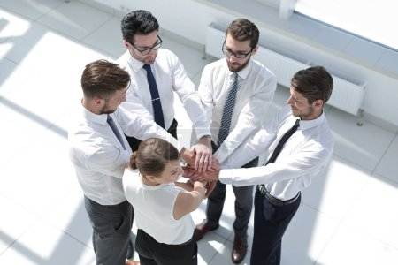 friendly business team with hands clenched together.