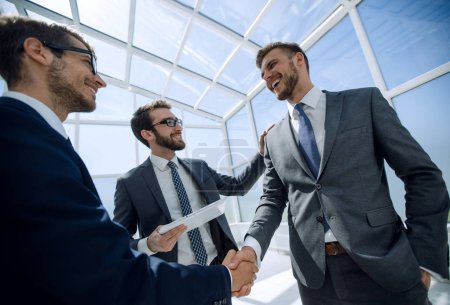 handshake business partners in a modern office
