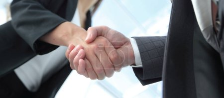 Photo for Successful businessmen handshaking after good deal. - Royalty Free Image