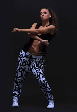 Photo for Young hip hop dancer isolated on a black background - Royalty Free Image