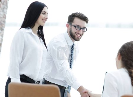 young business woman welcoming handshake with colleague
