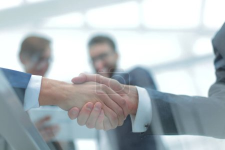 Photo for Two businessmen handshaking, congratulating on promotion. Close up. - Royalty Free Image