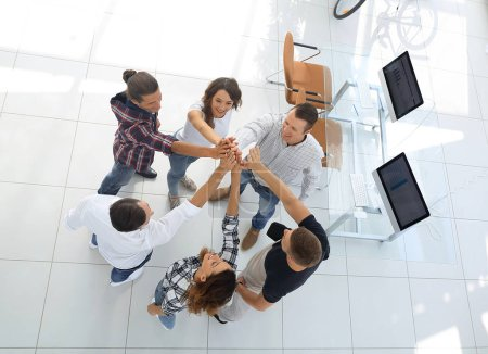 Photo for View from the top.creative team giving each other a high five.photo with copy space - Royalty Free Image