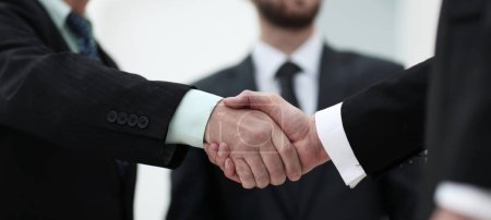Photo for Closeup handshake proven business partners. business background. - Royalty Free Image