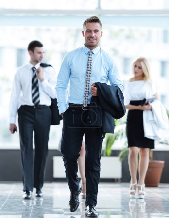 businessman standing in the center of the modern office