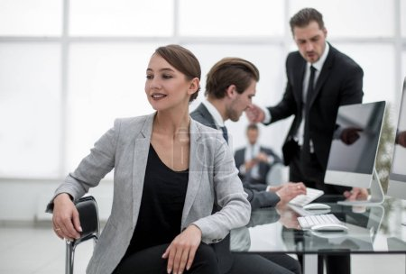 successful young woman in the workplace in the office